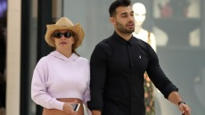 Britney Spears and boyfriend Sam Asghari hold hands while walking in the mall