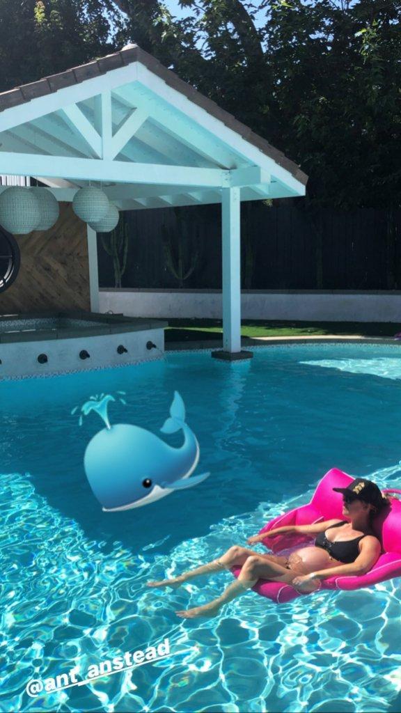Christina Anstead Wearing a Black Bikini in a Pool