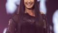 Demi Lovato Smiling On Stage in Sheer Black Top and Body Suit