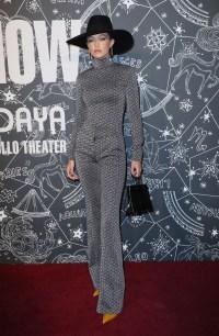 Model Gigi Hadid wearing a gray jumpsuit