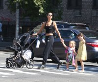 Irina Shayk Shows Off Her Toned Tummy (and Adorable Daughter!) During a Sunday Stroll in NYC