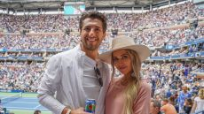 Kaitlyn Bristowe Wearing a White Hat and a Pink Dress With Jason Tartick Wearing a White Shirt at the US Open