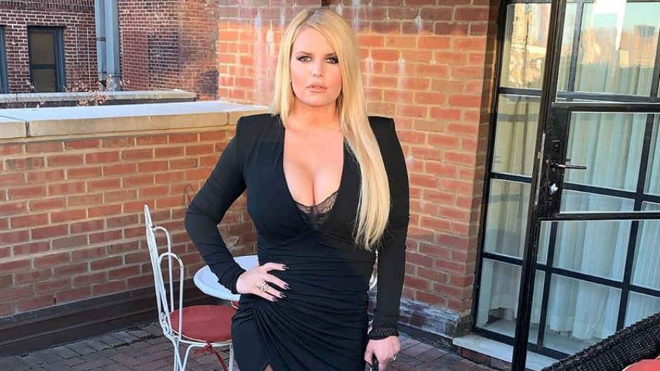 Jessica Simpson flaunts 100-pound weight loss while posing in a little black dress