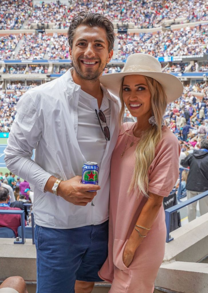 Kaitlyn Bristowe Wearing a Pink Dress With a Hat With Jason Tartick in a White Shirt With Jeans