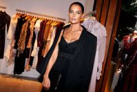 Katie Holmes Wearing a Black Dress at a NYFW Event
