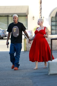 Pregnant Amber Rose Wears Red Dress and Holds Hands With Alexander AE Edwards