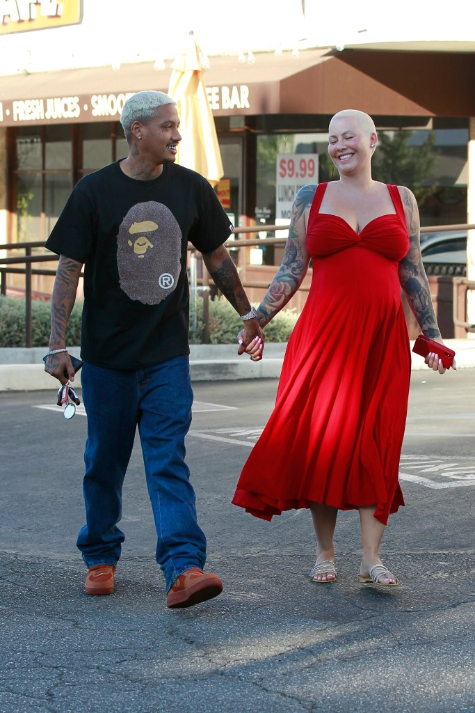 Pregnant Amber Rose Laughs With Alexander Edwards While Holding Hands
