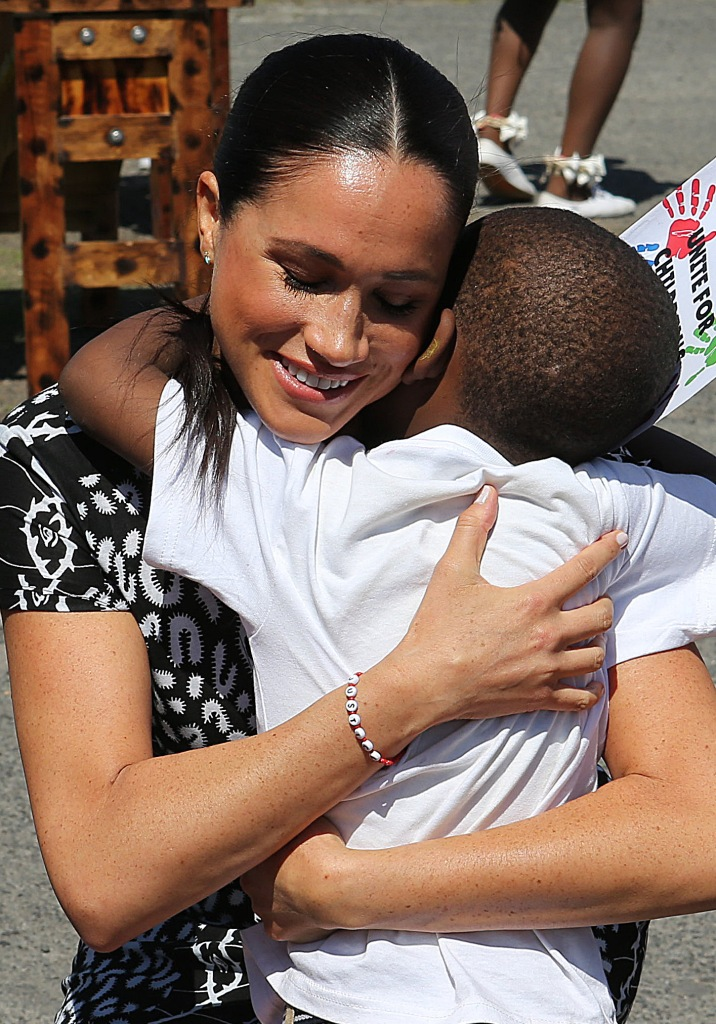 Meghan Markle Hugs a Child During Africa Tour