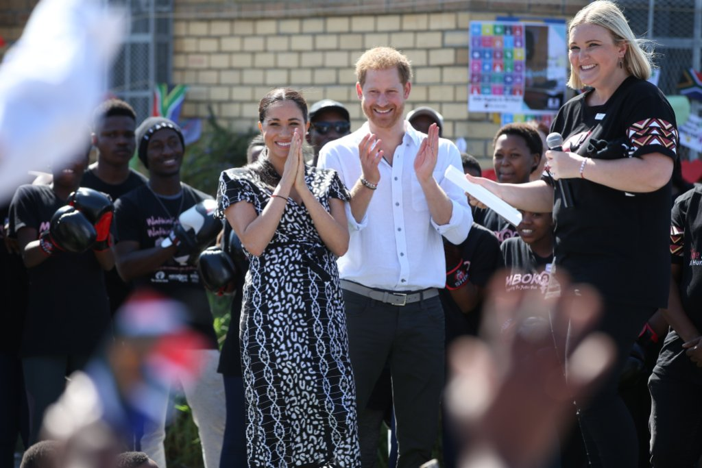 Duke and Duchess of Sussex tour of Africa Clapping and Smiling Meghan Markle and Prince Harry