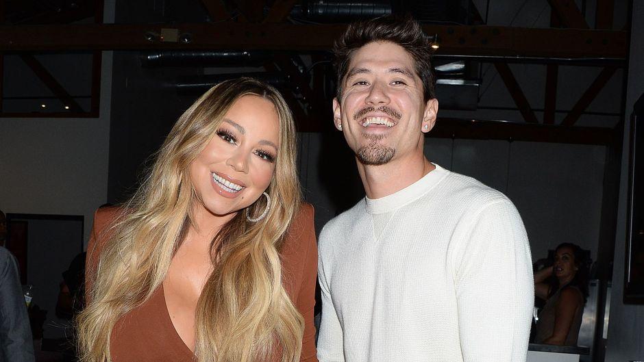 Mariah Carey and Bryan Tanaka smiling and holding hands