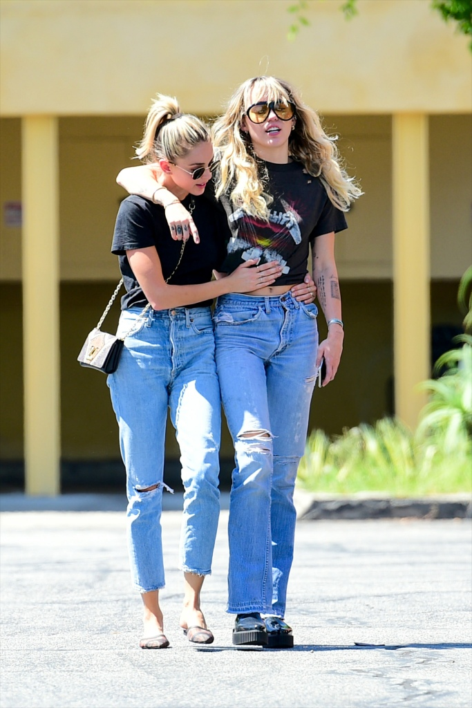 Miley Cyrus Walking With Kaitlynn Carter Wearing Jeans and Black T-Shirts in Los Angeles