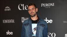 Nick Viall Wearing a Jean Jacket With Black Pants