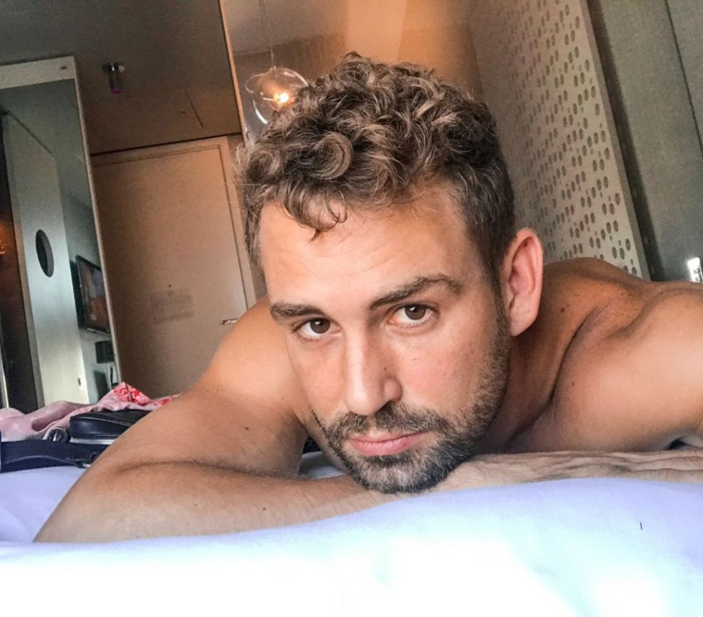 Nick Viall in Bed at a Hotel Taking a Selfie