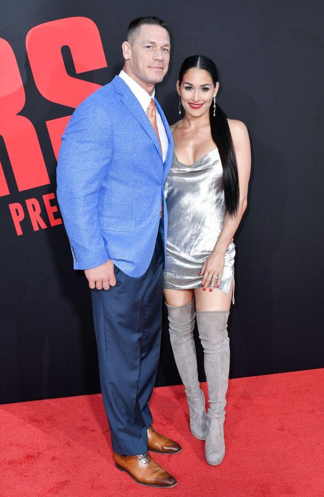 John Cena and Nikki Bella posing on the red carpet