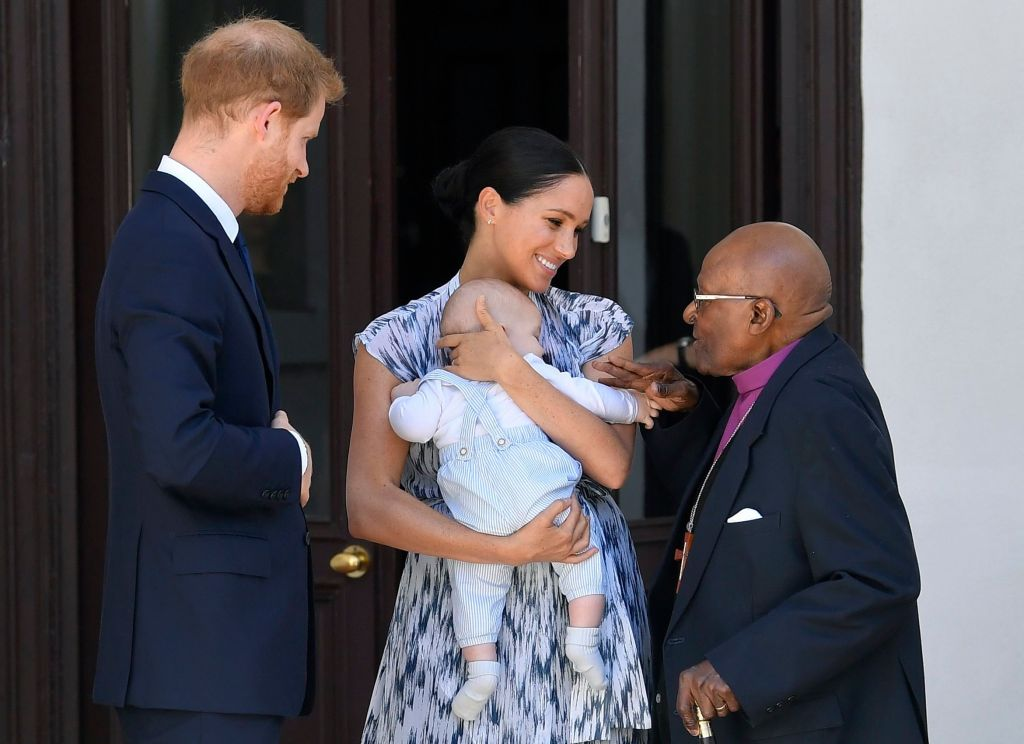 Prince Harry and Meghan Duchess of Sussex, holding their son Archie Harrison Mountbatten-Windsor, meet Archbishop Desmond Tutu