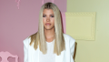 Sofia Richie wearing an all white outfit with straight hair parted down the middle