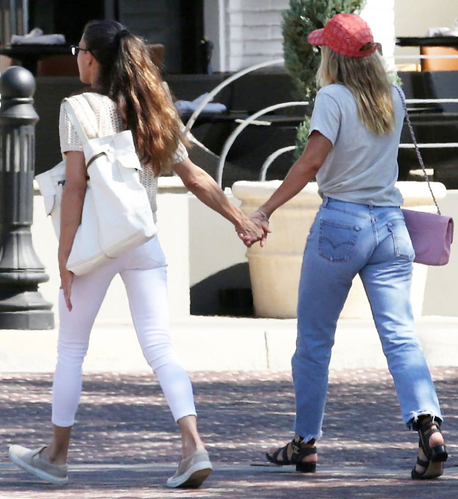 Sofia Richie Bonds With Mom Diane Alexander Over Lunch holding Hands