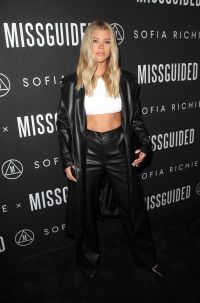Sofia Richie in a leather pantsuit and white crop top at her Missguided launch event