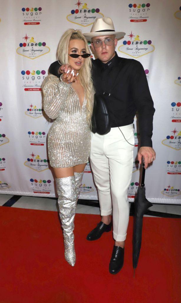 Tana Mongeau and Jake Paul holding hands