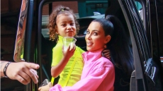 kim kardashian wears all pink while holding daughter north who is wearing all green