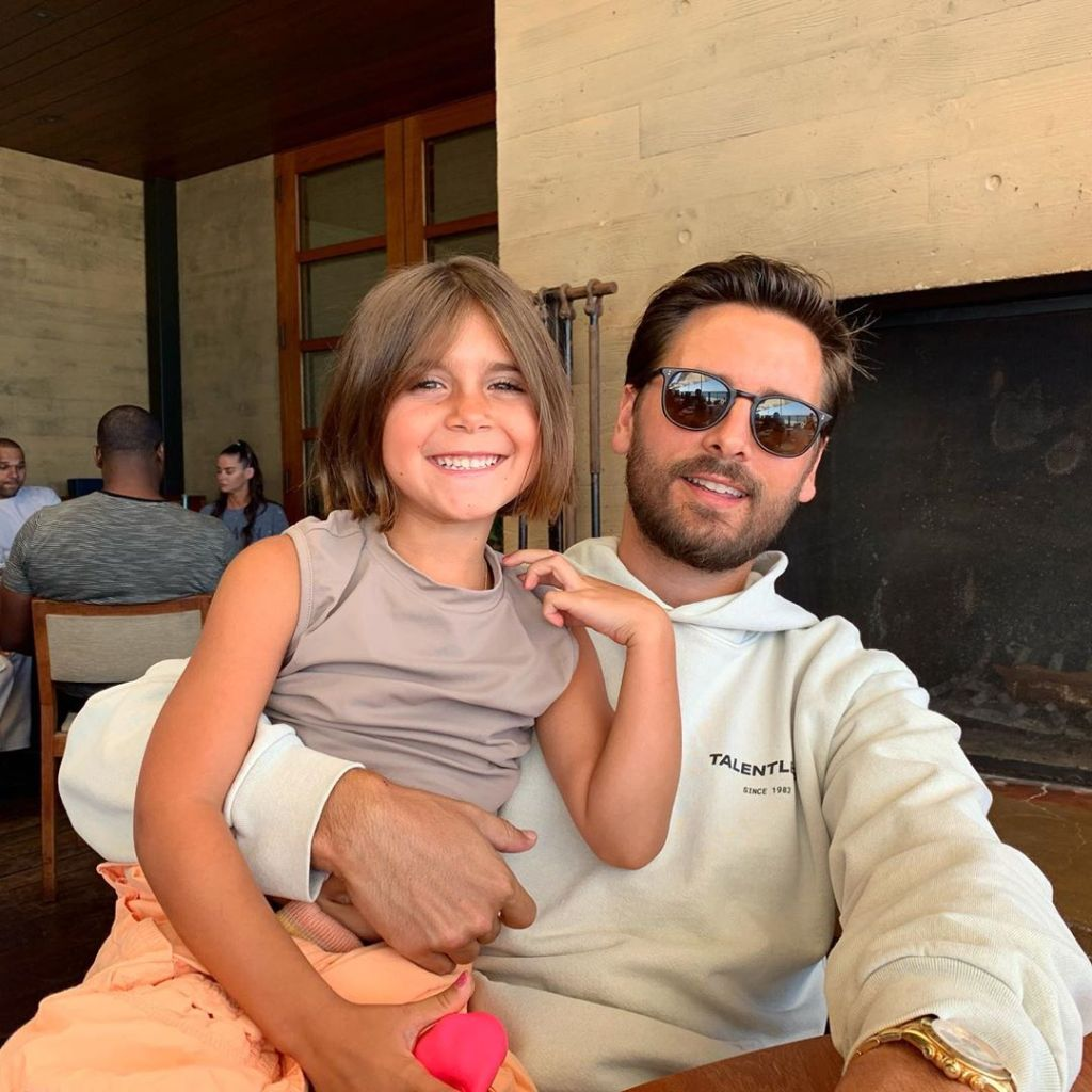 Penelope Disick Sits on Scott Disicks Lap and Smiles