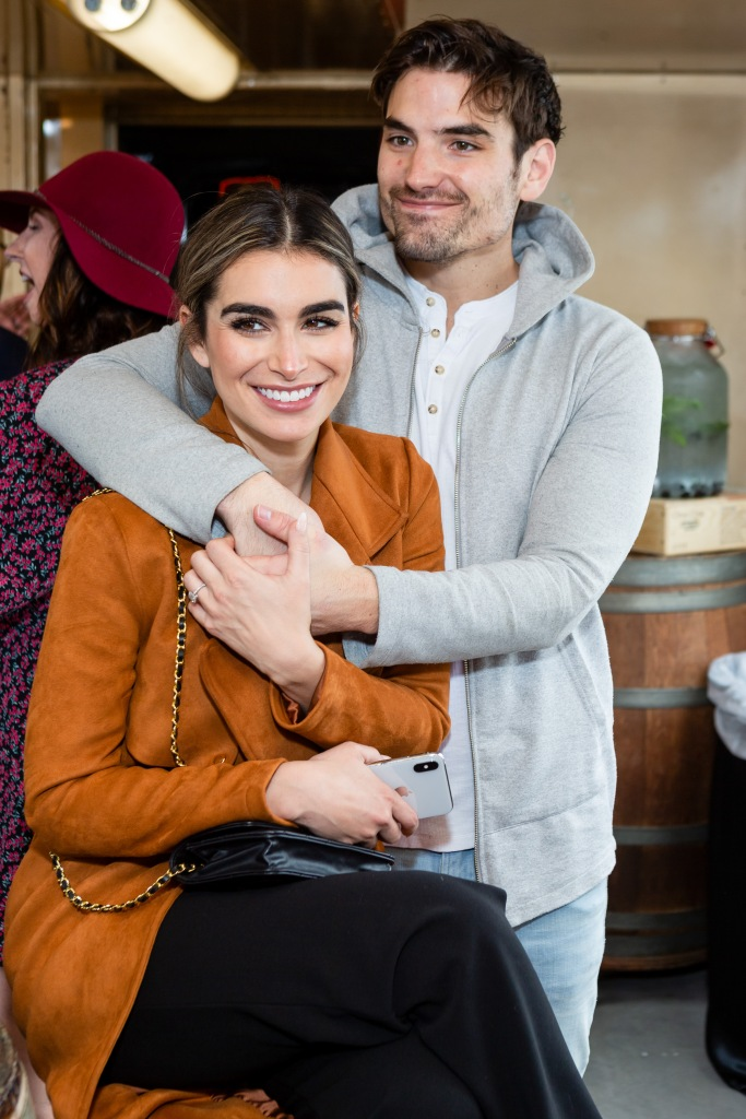 Ashley Iaconetti in Yellow Jacket and Jared Haibon in Grey Sweater Cuddle