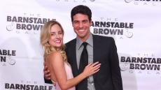 Kendall Long in Long Pink Dress Smiles with Her Arm Around Joe Amabile in a Suit