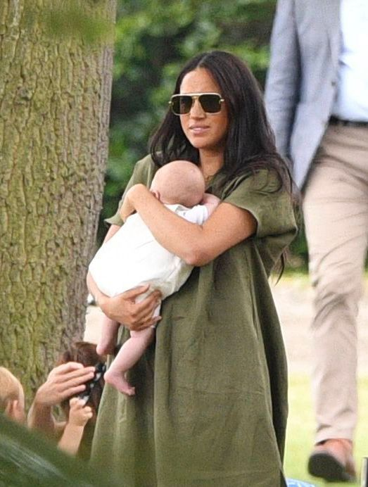 Meghan Markle Cradles Baby Archie in Green Dress