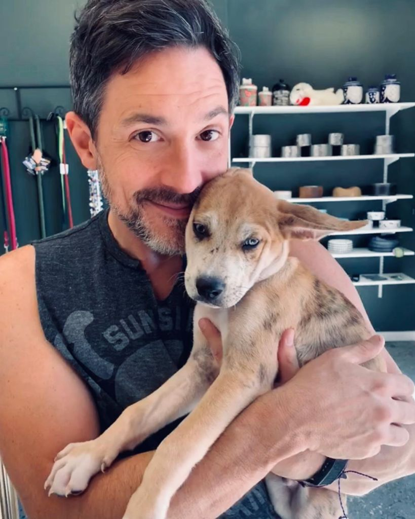 Steve Kazee Holds His Puppy Cosmo Who He Owns With Jenna Dewan