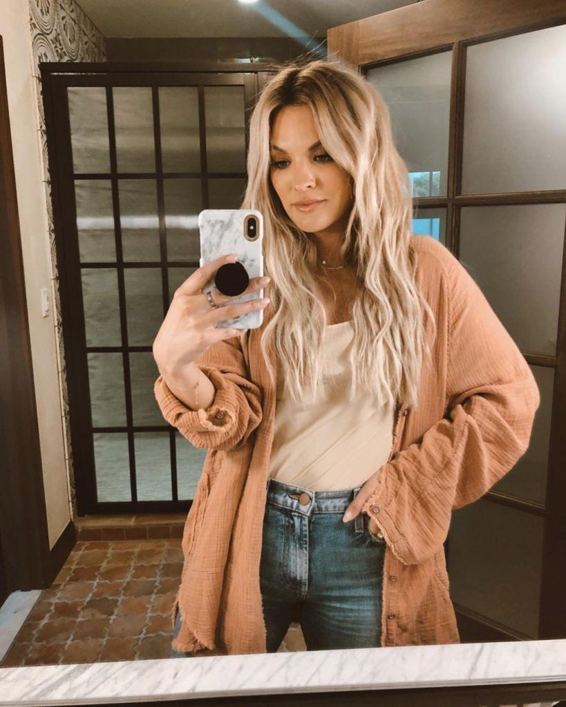 Becca Tilley Wearing a Sweater Taking a Mirror Selfie