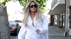 Khloe Kardashian shopping for baby supplies in jeans and a white blouse