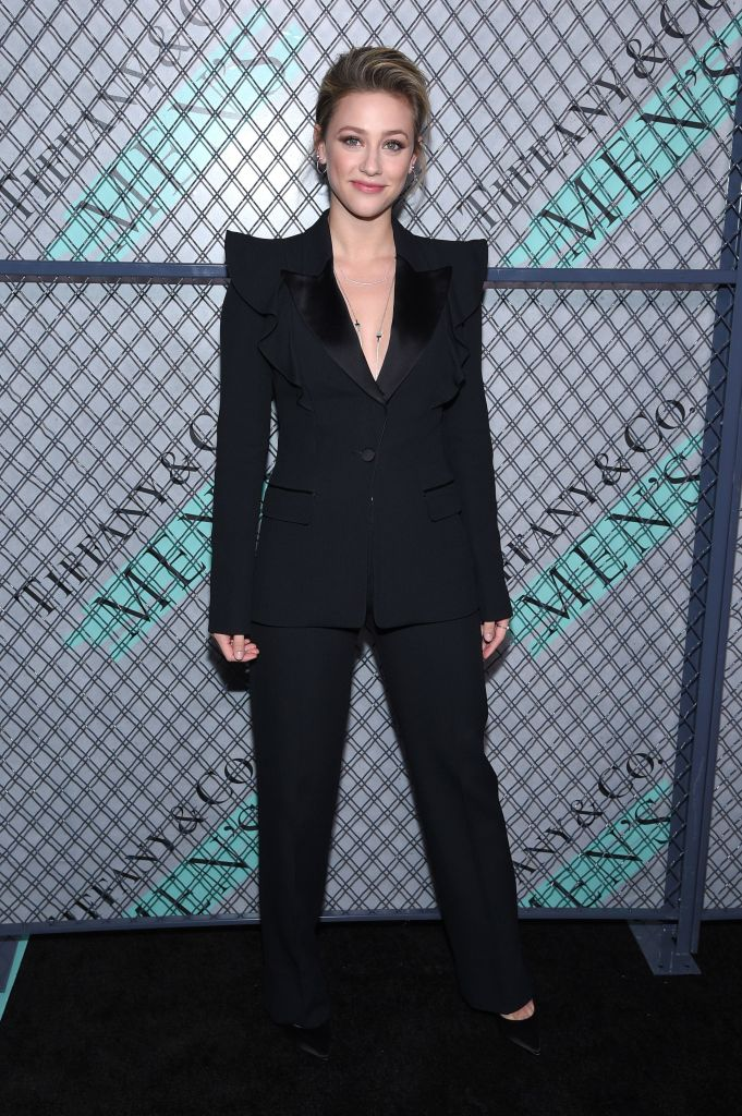 Lili Reinhart Wears a Black Pantsuit While Discussing Her Upcoming Book of Poems 'Swimming Lessons'
