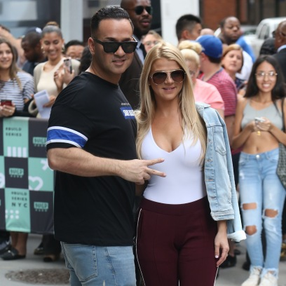 Lauren Sorrentino Wearing a White Tank Top With Pants With Mike The Situation Sorrentino