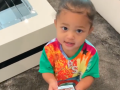 Stormi Webster Wears a Tie-Dye T-Shirt While Listening to Kylie Jenner's Rise and Shine