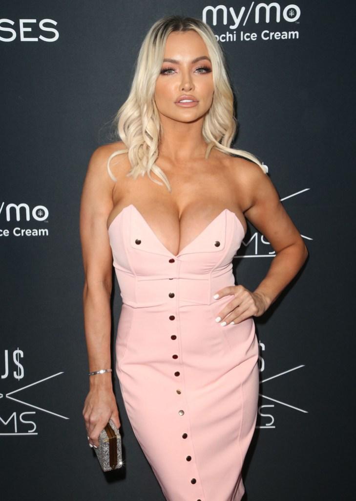 Lindsey Pelas Poses in Pale Pink Dress