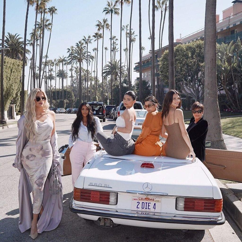 Khloe, Kim, Kylie, Kourtney, Kendall and Kris Jenner Posing on a Car