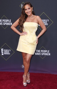 Adrienne Bailon Wearing a Yellow Dress