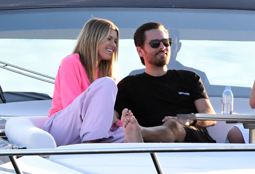 Scott Disick Wearing a Black Shirt With Sofia Richie in a Gray Top and Pink Pants on a Boat in Miami