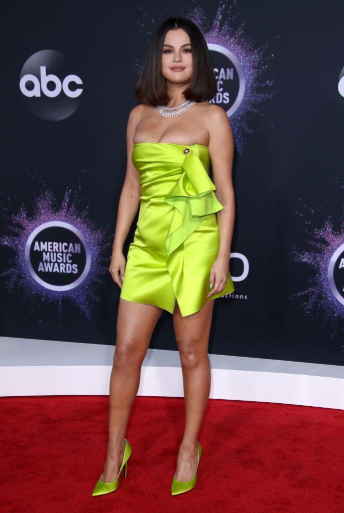 Selena Gomez Wearing a Neon Dress