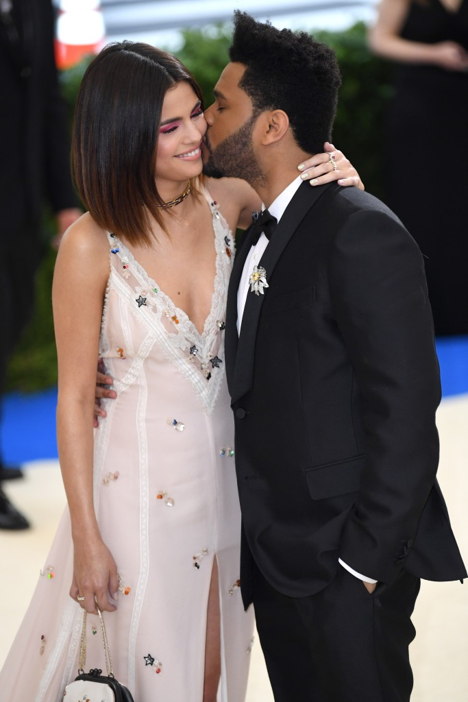 Selena Gomez Wearing a Pink Dress With The Weeknd