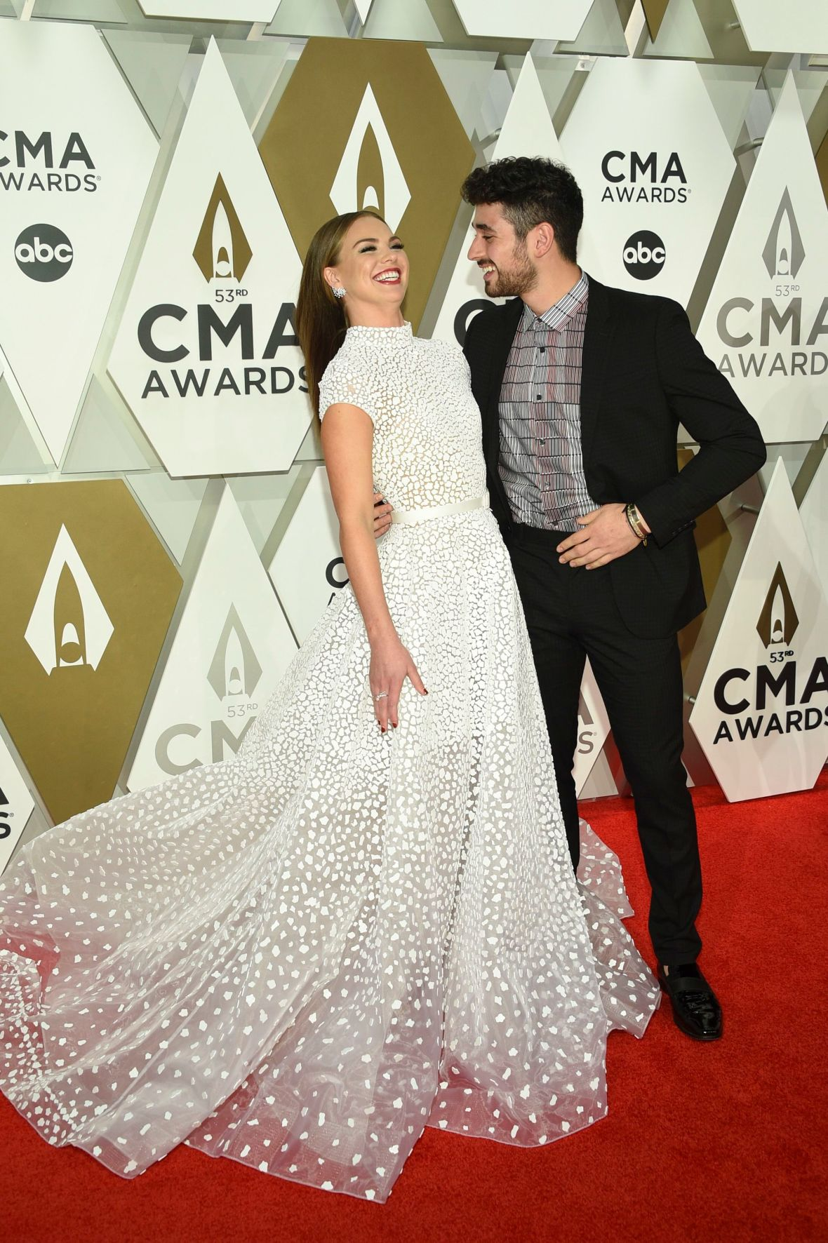 Hannah Brown and Alan Bersten Giggle on Red Carpet at CMAs