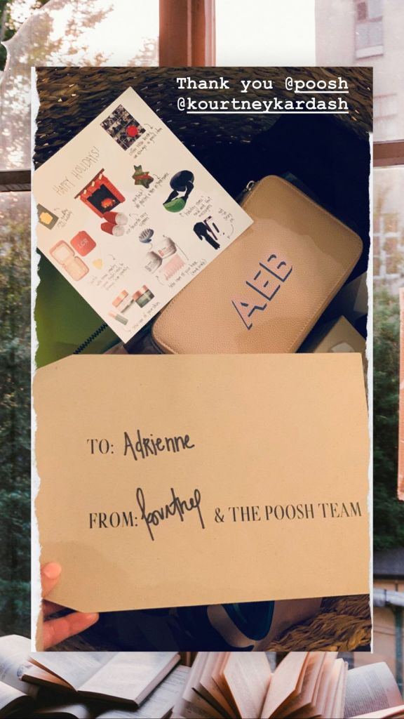 Adrienne Bailon Unboxes a Holiday Package from Kourtney Kardashian