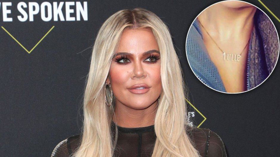 Khloe Kardashian With Long Blonde Hair Wearing Sheer Black Spatle Uop, Inset True Necklace With Block Lettering