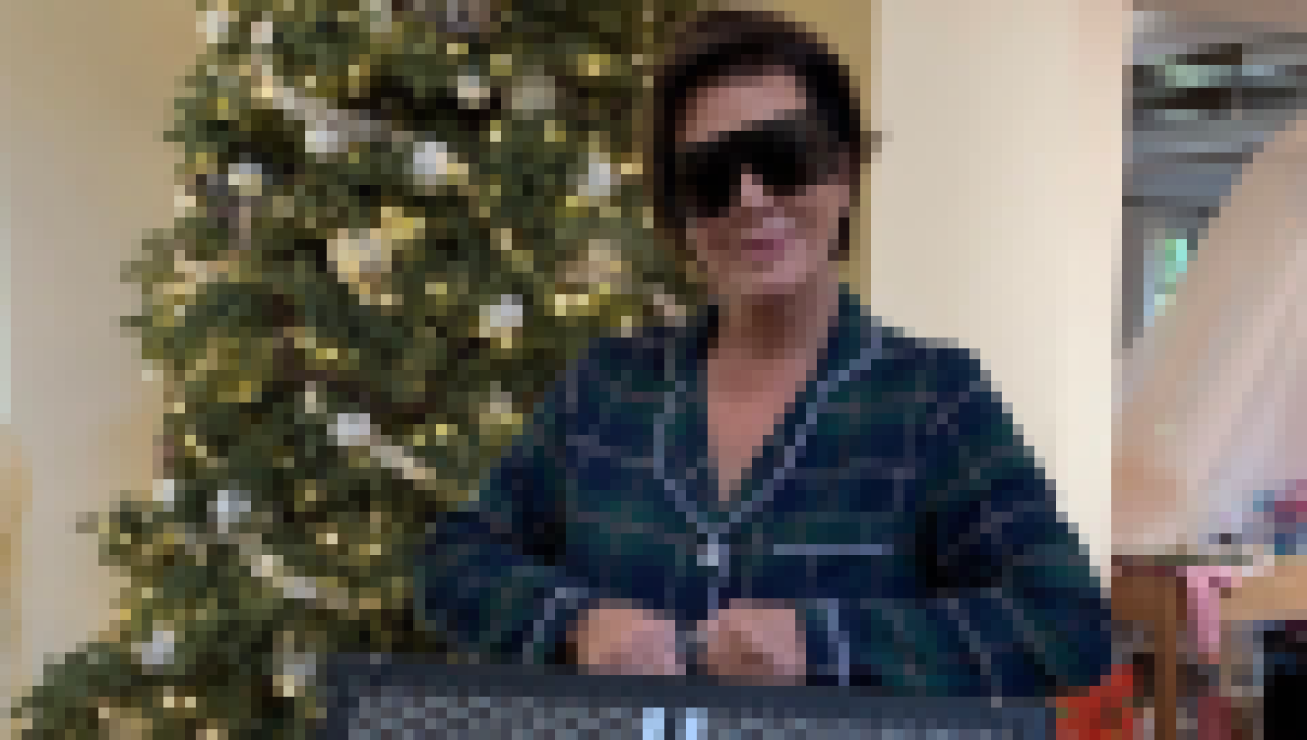 Kris Jenner Posing in Front of a Christmas Tree