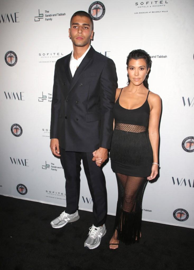 Kourtney Kardashian Wearing a Black Dress With Younes Bendjima