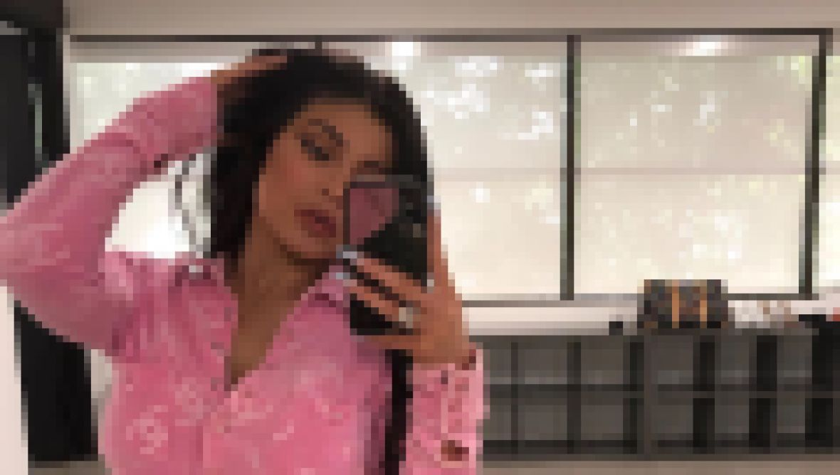 Kylie Jenner Wearing a Pink Top While Taking a Mirror Selfie