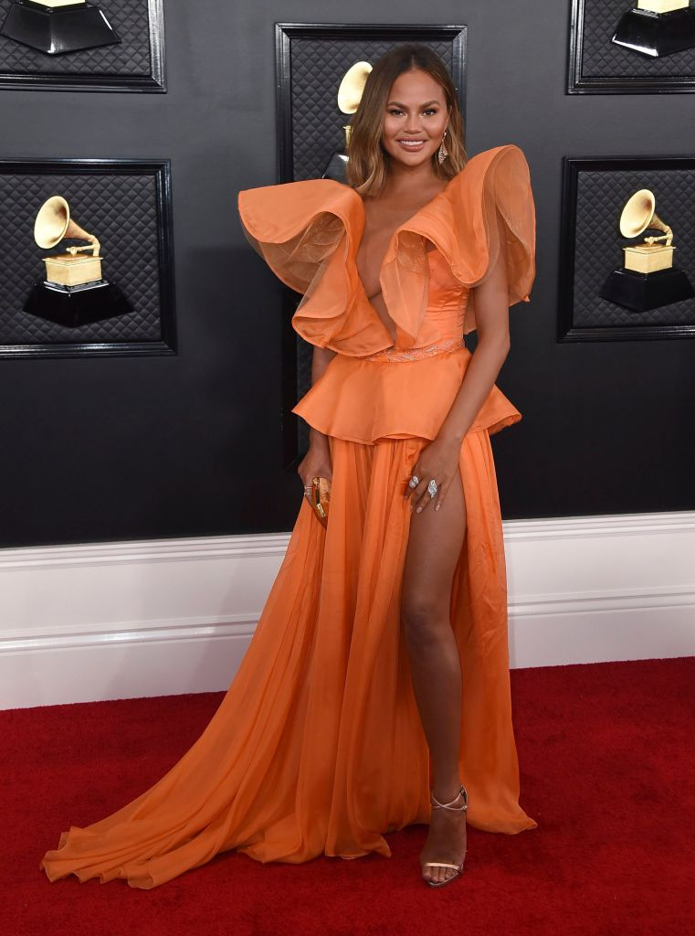 Chrissy Teigen in Orange Gown at the 2020 Grammys