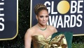 Jennifer Lopez on Golden Globes Red Carpet in Gold, Green and White Gown