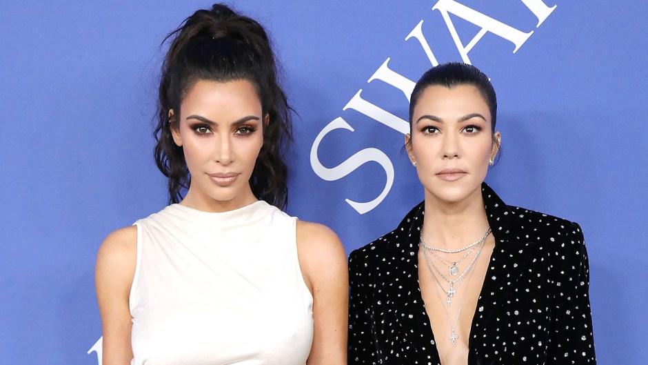 Kim Kardashian West and Kourtney Kardashian attend the 2018 CFDA Fashion Awards