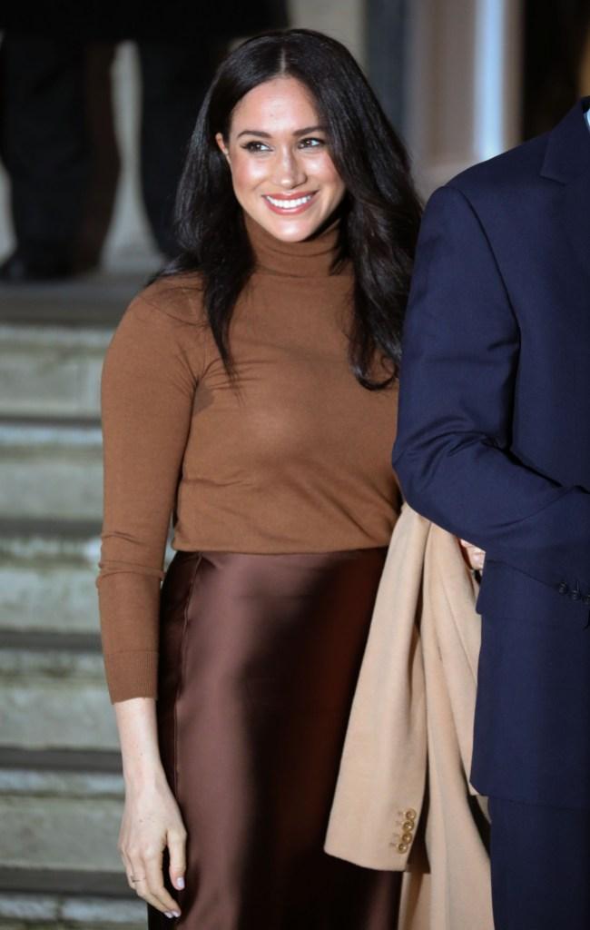 Meghan Markle Wearing a Tan Sweater